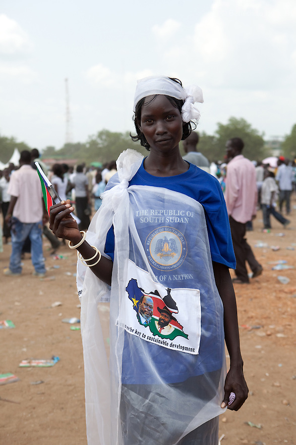 Saturday 9 july 2011 - Juba, Republic of South Sudan - A South Sudanese girl waves the flag of her new country during South Sudan's independence day celebrations in Juba. Tens of thousands of citizens of the new South Sudan celebrate national independence but whether statehood will resolve issues of identity after a decades-long war remains to be seen. Photo credit: Benedicte Desrus