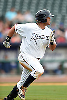 NW Arkansas Naturals first baseman Juan Graterol (35) runs to first during a game against the Corpus Christi Hooks on May 26, 2014 at Arvest Ballpark in Springdale, Arkansas.  NW Arkansas defeated Corpus Christi 5-3.  (Mike Janes/Four Seam Images)