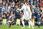 Real Madrid's Alvaro Morata and Malaga CF's Michael Nicolas Santos during La Liga match between Real Madrid and Malaga CF at Santiago Bernabeu Stadium in Madrid, Spain. January 21, 2017. (ALTERPHOTOS/BorjaB.Hojas)