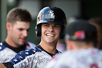 Mitch Roman (10) of the Kannapolis Intimidators is all smiles after returning to the dugout after hitting a solo home run against the Delmarva Shorebirds at Kannapolis Intimidators Stadium on June 30, 2017 in Kannapolis, North Carolina.  The Shorebirds defeated the Intimidators 6-4.  (Brian Westerholt/Four Seam Images)