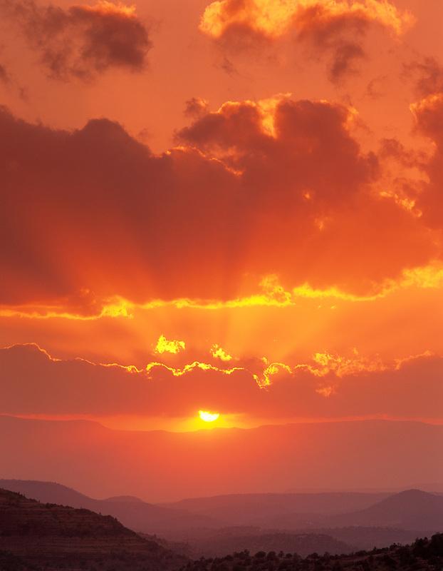 Sunset clouds with sun rays. Near Sedona, Arizona