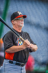 20 September 2013: Miami Marlins first base coach Perry Hill taps out infield grounders prior to a game against the Washington Nationals at Nationals Park in Washington, DC. The Nationals defeated the Marlins 8-0 to take the second game of their 4-game series. Mandatory Credit: Ed Wolfstein Photo *** RAW (NEF) Image File Available ***