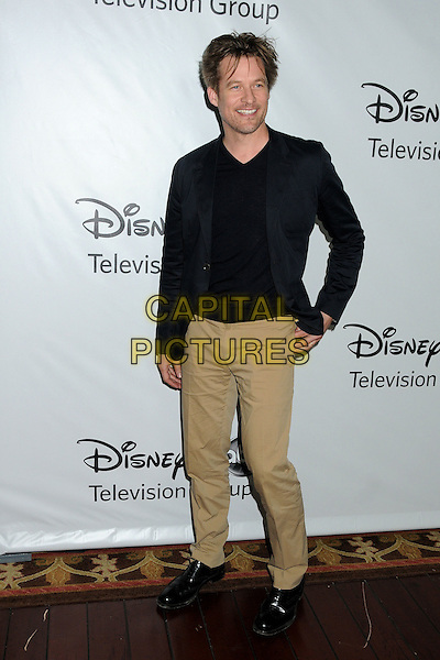 James Tupper.Disney ABC 2012 TCA Winter Press Tour held at the Langham Huntington Hotel, Pasadena, California, USA..January 10th, 2012.full length black jacket top beige trousers .CAP/ADM/BP.©Byron Purvis/AdMedia/Capital Pictures.