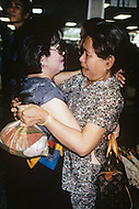 In Ho Chi Minh City, Saigon, February 1988. Two sisters, separated for fifteen years, are reunited at the Tan Son Nut airport in Ho Chi Minh City.