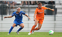 Defender Brittany Taylor (14) of Sky Blue turns the ball away from forward Tiffany Weimer (8) of the Boston Breakers.  The Breakers and Sky Blue played to a scoreless tie at Yurcak Field in Picataway, NJ, on Saturday, May 29th.