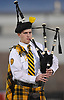 A St. Anthony's student plays a rendition of America the Beautiful on the bagpipes before a varsity football game against Monsignor Farrell at St. Anthony's High School on Friday, Sept. 29, 2017.