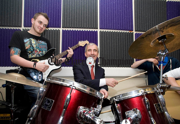 Gay Mitchell, Fine Gael presidential candidate, sits in on drums with Shane Dwane at the Clare Youth Centre during his recent visit to Ennis. Photograph b Declan Monaghan