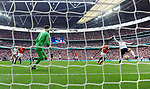 Dele Alli of Tottenham Hotspur scores the opening goal of the game past Manchester United goalkeeper David De Gea during the FA cup semi-final match at Wembley Stadium, London. Picture date 21st April, 2018. Picture credit should read: Robin Parker/Sportimage