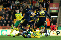 1st December 2019; Carrow Road, Norwich, Norfolk, England, English Premier League Football, Norwich versus Arsenal; Tom Trybull of Norwich City slide tackles Alexandre Lacazette of Arsenal - Strictly Editorial Use Only. No use with unauthorized audio, video, data, fixture lists, club/league logos or 'live' services. Online in-match use limited to 120 images, no video emulation. No use in betting, games or single club/league/player publications