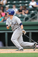 Catcher Ashley Graeter (6) of the Asheville Tourists bats in a game against the Greenville Drive on Sunday, July 20, 2014, at Fluor Field at the West End in Greenville, South Carolina. Asheville won game two of a doubleheader, 3-2. (Tom Priddy/Four Seam Images)