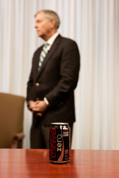 March 26, 2013. Columbia, South Carolina. The Coke Zero can of Sen. Lindsey Graham as he conducted a FOX NEWS interview after addressing members of the press on the issue of immigration reform. He was joined by Dr. Jim Goodroe, a state evangelical leader, and Hal Stevenson, the owner of Grace Outdoor.. Sen. Lindsey Graham, R- South Carolina, is up for reelection in 2014. He spent some time talking to his base back home about issues such as immigration reform as he readies himself for his campaign run..