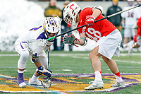 University at Albany Men's Lacrosse defeats Cornell 11-9 on Mar 4 at Casey Stadium.  T.D. Ierlan (#3) wins a faceoff against Brandon Salvatore (#48).