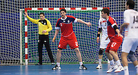 08 JAN 2012 - LONDON, GBR - Great Britain goalkeeper Bobby White (left, in yellow and black) watches the ball during the men's 2013 World Handball Championships qualification match against Austria at the National Sports Centre in Crystal Palace, Great Britain .(PHOTO (C) 2012 NIGEL FARROW)