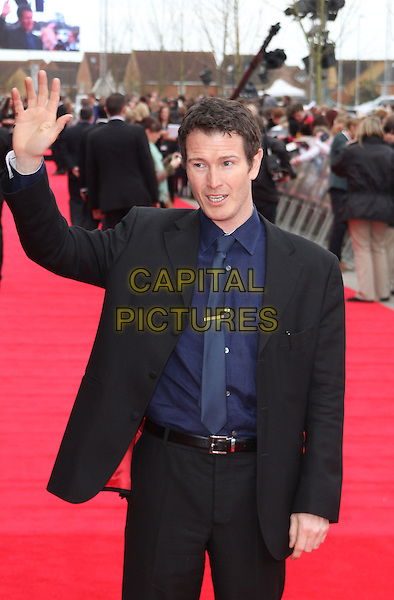 Nick Moran.'Warners Bros Studio Tour - The Making of Harry Potter' Grand Opening at Leavesden Studios, Watford, Hertfordshire, England..March 31st 2012.half length suit shirt hand arm in air waving black blue  .CAP/ROS.©Steve Ross/Capital Pictures