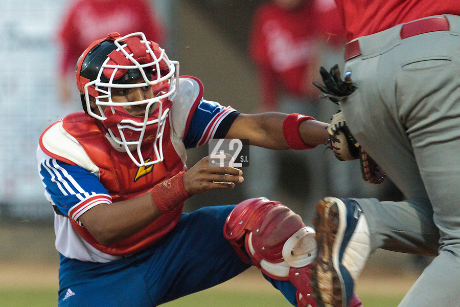 21 August 2010: Andy Paz of Team France makes a tag at home plate during Russia 13-1 win in 7 innings over France, at the 2010 European Championship, under 21, in Brno, Czech Republic.