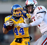 BROOKINGS, SD - NOVEMBER 22:  Brady Mengarelli #44 from South Dakota State University is brought down by Kyle Guziec #54 from the University of South Dakota in the first half of their game Saturday at Coughlin Alumni Stadium in Brookings. (Photo by Dave Eggen/Inertia)