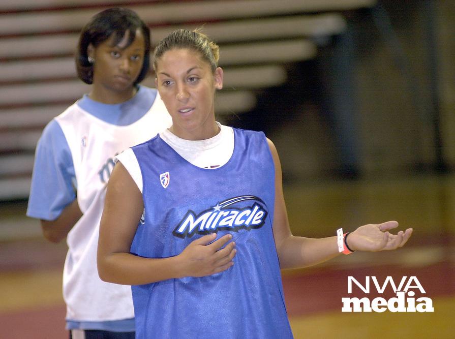Arkansas Democrat-Gazette/MICHAEL WOODS<br />Dana Cherry (left) and India Lewis  talk to students at basketball camp.