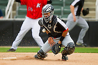 Hickory Crawdads catcher Jorge Alfaro (11) blocks a throw to the plate during the game against the Kannapolis Intimidators at CMC-Northeast Stadium on April 14, 2013 in Kannapolis, North Carolina.  The Intimidators defeated the Crawdads 6-0.  (Brian Westerholt/Four Seam Images)