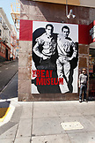 USA, California, San Francisco, Brandon Loberg stands in front of the Beat Museum and in North Beach, Broadway street