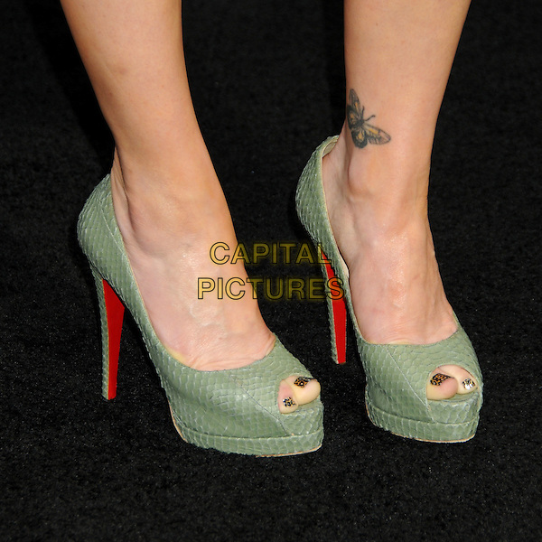 """CARLA GUGINO's shoes .""""A Nightmare On Elm Street"""" Los Angeles Premiere held at Grauman's Chinese Theatre, Hollywood, California, USA, 27th April 2010..detail feet green platform shoes heels peep toe Christian Louboutin butterfly tattoo on ankle crystal pedicures crystals on toes snakeskin snake .CAP/ADM/BP.©Byron Purvis/AdMedia/Capital Pictures."""