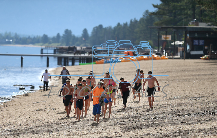 Local students swim at Lake Tahoe near the 18th annual Lake Tahoe Summit at the Valhalla Estate in South Lake Tahoe, Ca., on Tuesday, Aug. 19, 2014. <br /> Photo by Cathleen Allison