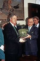 United States President Bill Clinton, left, participates in the annual presentation of a bowl of shamrocks honoring St. Patrick's Day with Taoiseach (Prime Minister) Albert Reynolds of Ireland, right, in the Roosevelt Room of the White House in Washington, DC on March 17, 1993. During his remarks, President Clinton announced he was naming Jean Kennedy Smith as US Ambassador to Ireland.<br /> Credit: Martin H. Simon / Pool via CNP/AdMedia
