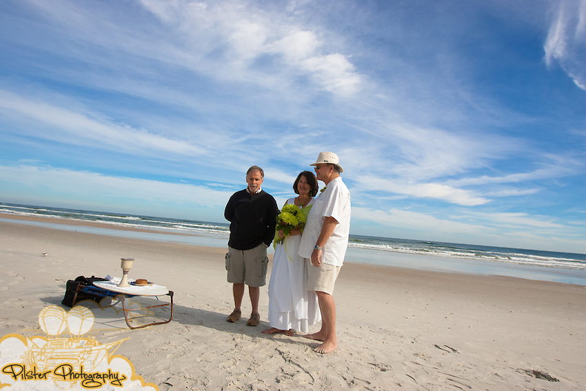 Susan and Mac McClelland renew their vows as their family watches on Saturday, November 28, 2009, in New Smyrna Beach, Florida. (Chad Pilster, http://www.PilsterPhotography.net)