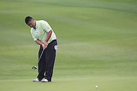 Su Dong (CHN) putts on the 9th green during Saturay's Round 3 of the 2014 BMW Masters held at Lake Malaren, Shanghai, China. 1st November 2014.<br /> Picture: Eoin Clarke www.golffile.ie