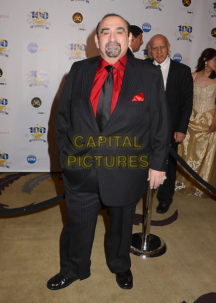 Ken Davitian.23nd Annual Night of 100 Stars Awards Gala hosted by Norby Walters celebrating the 85th Annual Academy Awards held at the Beverly Hills Hotel, Beverly Hills, California, USA..February 24th, 2013.full length black suit red shirt goatee facial hair .CAP/ADM/BT.©Birdie Thompson/AdMedia/Capital Pictures.