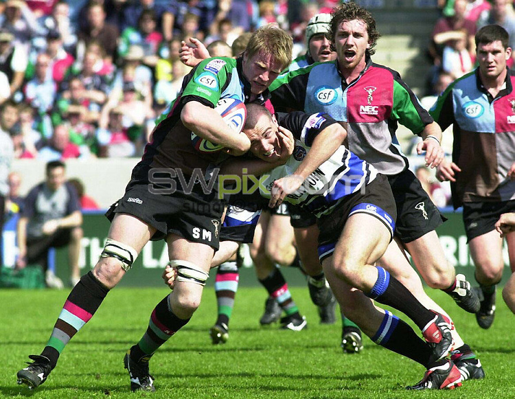 PIX: Rugby. Zurich Premiership. Harlequins-Bath, The Stoop, 2/05/2004..COPYRIGHT PICTURE>> SIMON WILKINSON>>0870 092 0092>>..Harlequins' Simon Miall is tackled by Bath's Spencer Davey..