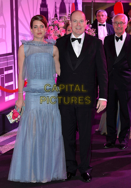 Charlotte Casiraghi, Prince Albert of Monaco.Rose Ball 2012 - Swinging London, Monte Carlo Bay Hotel, Monte Carlo, 24th March 2012..full length blue dress royal royalty black bow tie tuxedo .CAP/PPG.©People Picture/Capital Pictures