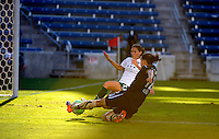 Red Stars defender Lydia Vanderbergh (21) slides to prevent a sure goal by FC Gold Pride midfielder Christine Sinclair (12).  The FC Gold Pride defeated the Chicago Red Stars 3-2 at Toyota Park in Bridgeview, IL on August 22, 2010