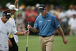 "6 September 2008:   Jim Furyk hands his club to his caddy, Mike ""Fluff"" Cowan on the eighth hole in the third round of play at the BMW Golf Championship at Bellerive Country Club in Town & Country, Missouri, a suburb of St. Louis, Missouri. Furyk was the leader after the conclusion of round two with a score of 62.  After the first nine holes of the 18-hole third round, Furyk was 11 under-par.  The BMW Championship is the third event of the Fed Ex Cup and the top 30 finishers will qualify for the next event of the championship."