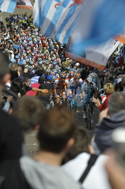 Fans throng the streets as the peleton approaches the first real test of the race Cote de Saint Roch during the 95th running of Liege-Bastogne-Liege cycle race, running 261km from Liege to Ans, Belgium. 26th April 2009 (Photo by Eoin Clarke/NEWSFILE)