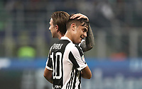 Calcio, Serie A: Inter - Juventus, Milano, stadio Giuseppe Meazza (San Siro), 28 aprile 2018.<br /> Juventus' Paulo Dybala and Federico Bernardeschi celebrate after winning 3-2 the Italian Serie A football match between Inter Milan and Juventus at Giuseppe Meazza (San Siro) stadium, April 28, 2018.<br /> UPDATE IMAGES PRESS/Isabella Bonotto