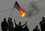 Palestinian Hamas supporters burn a representation of the U.S. flag during a demonstration against the visit of U.S. President George W. Bush to Israel and the West Bank, in Gaza City, Wednesday, Jan. 9, 2008. Thousands of Palestinian hard-liners in Gaza staged protests against George W. Bush on Wednesday, burning Bush in effigy and underscoring the deep political split with West Bank moderates who welcomed the visit of the U.S. president as an important gesture to the Palestinians. Photo By: JINIPIX / Fady Adwan