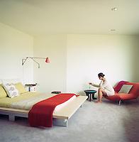 Portrait of jewellery designer Chan Luu sitting in her bedroom