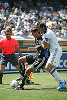 Chris Wondolowski (17) maintains control against Chris Klein (right). San Jose Earthquakes defeated LA Galaxy 2-1 at the Oakland-Alameda County Coliseum in Oakland, California on June 20, 2009.