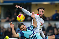 Josh Payne of Crawley Town fouls Sam Wood of Wycombe Wanderers during the Sky Bet League 2 match between Wycombe Wanderers and Crawley Town at Adams Park, High Wycombe, England on 25 February 2017. Photo by Andy Rowland / PRiME Media Images.