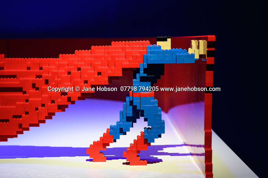 "London, UK. 28.02.2017. THE ART OF THE BRICK: DC SUPER HEROES - Artist Nathan Sawaya returns to London with the world's largest LEGO exhibition, inspired by Batman, Superman, and Wonder Woman. The exhibition opens, in a purpose-built marquee in Doon Street car park, Upper Ground, on the South Bank. Picture shows"" Pushing. Photograph © Jane Hobson."