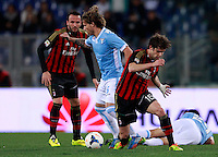 Calcio, Serie A: Lazio vs Milan. Roma, stadio Olimpico, 23 marzo 2014.<br /> Lazio midfielder Lucas Biglia, of Argentina, center, is challenged by AC Milan midfielder Andrea Poli, right, past AC Milan forward Giampaolo Pazzini, left, and Lazio midfielder Cristian Ledesma, bottom right, during the Italian Serie A football match between Lazio and AC Milan at Rome's Olympic stadium, 23 March 2014. The game ended 1-1.<br /> UPDATE IMAGES PRESS/Isabella Bonotto