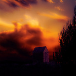 A small shed set against a red sky