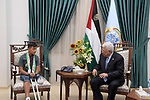 Palestinian President Mahmoud Abbas meets with Abdulrahman Nofal, 13, a wounded child lost his leg during the weekly protest near the Israel-Gaza border, in the West Bank city of Ramallah, June 19, 2019. Photo by Thaer Ganaim