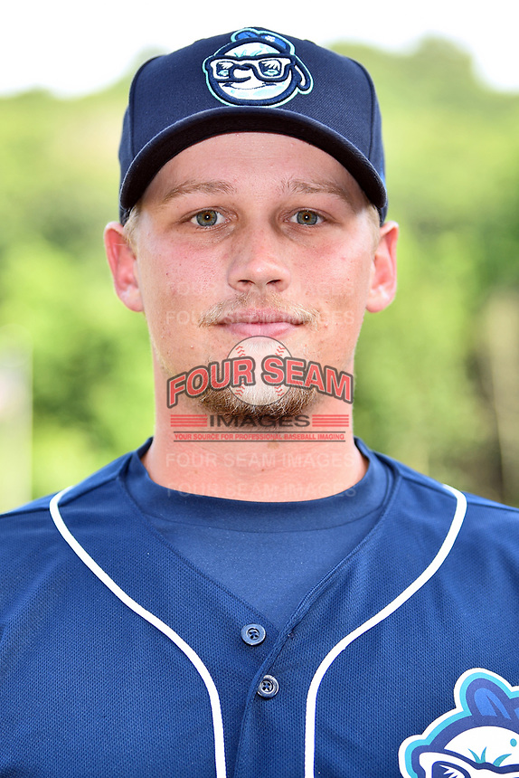 Asheville Tourists pitcher Austin Moore (16) before a game against the Charleston RiverDogs at McCormick Field on July 6, 2017 in Asheville, North Carolina. The Tourists defeated the RiverDogs 13-9. (Tony Farlow/Four Seam Images)