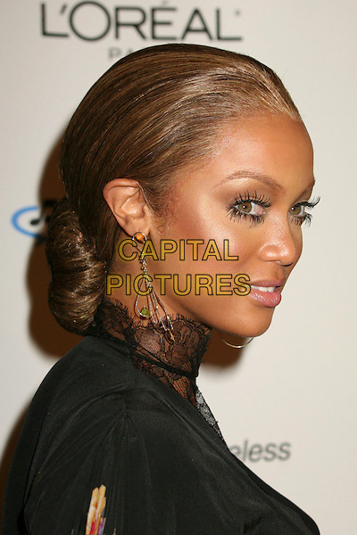 TYRA BANKS.Clive Davis 2007 Pre-Grammy Awards Party at the Beverly Hilton Hotel, Beverly Hills, USA..February 10th, 2007.headshot portrait lace earrings dangling fake eyelashes black.CAP/ADM/BP.©Byron Purvis/AdMedia/Capital Pictures