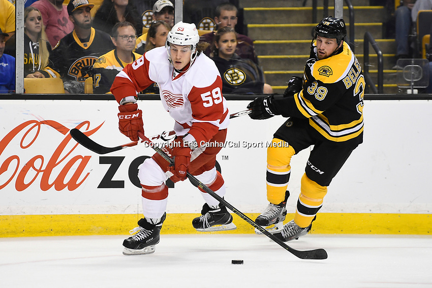 Monday, September 28, 2015, Boston, MA -  Detroit Red Wings left wing Tyler Bertuzzi (59) tried to clear the puck from his defensive zone with pressure form Boston Bruins left wing Matt Beleskey (39) during the NHL game between the Detroit Red Wings and the Boston Bruins held at TD Garden, in Boston, Massachusetts. Detroit defeats Boston 3-1 in regulation time. Eric Canha/CSM