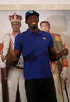 Il velocista giamaicano Usain Bolt tiene una conferenza stampa in occasione della sua partecipazione al Golden Gala di atletica leggera in programma allo stadio Olimpico il 6 giugno, a Roma, 4 giugno 2013.<br /> Jamaican sprinter Usain Bolt poses as he arrives for a press conference ahead of the IAAF Golden Gala athletics meeting scheduled at the Olympic stadium on 6 June, in Rome, 4 june 2013.<br /> UPDATE IMAGES PRESS/Isabella Bonotto