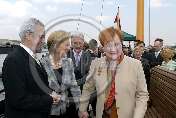 GENT - BELGIUM - 31 MARCH 2004--Official State Visit of the Finnish President Tarja HALONEN and her Husband Pentti ARAJÄRVI (Arajaervi) to Belgium. Stora Enso visit on the Le Barge ship.-- King Albert (C) and Queen Paola (2nd L) with Tarja HALONEN (R) on the ship. -- PHOTO: JUHA ROININEN / EUP-IMAGES
