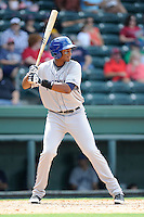 First baseman Correlle Prime (32) of the Asheville Tourists bats in a game against the Greenville Drive on Sunday, July 20, 2014, at Fluor Field at the West End in Greenville, South Carolina. Asheville won game one of a doubleheader, 3-1. (Tom Priddy/Four Seam Images)