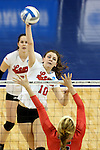 SIOUX FALLS, SD - DECEMBER 8:  Caroline Stefanon #10 from Lewis looks to get the ball past Haley Kindall #6 from Wheeling Jesuit during their quarterfinal match at the 2016 Women's Division II Volleyball Championship at the Sanford Pentagon in Sioux Falls, SD. (Photo by Dave Eggen/Inertia)